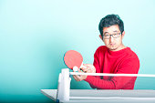 man playing table tennis