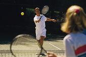 Man playing tennis match