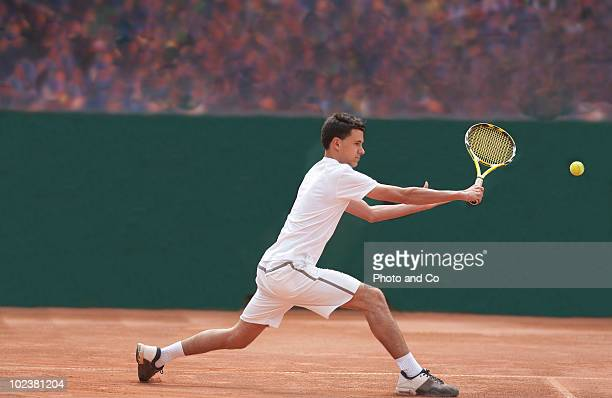 Man playing tennis on clay court