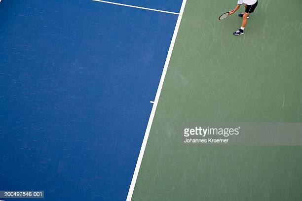 Man playing tennis, overhead view