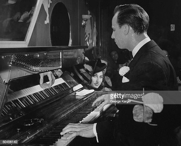 A man playing the piano at the Monkey Bar of the Hotel ElysTe