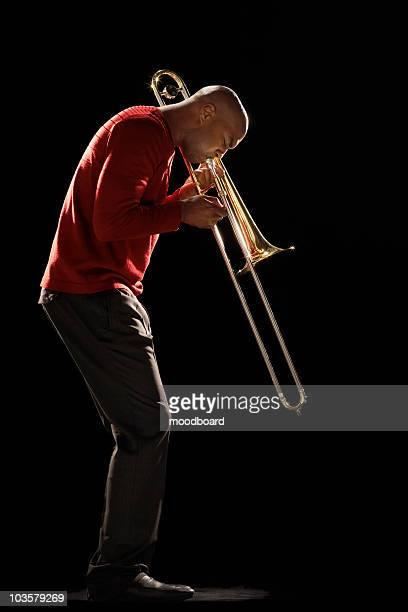 Man Playing Trombone, side view