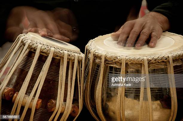 A man playing two tablas