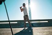 Man playing urban golf on street