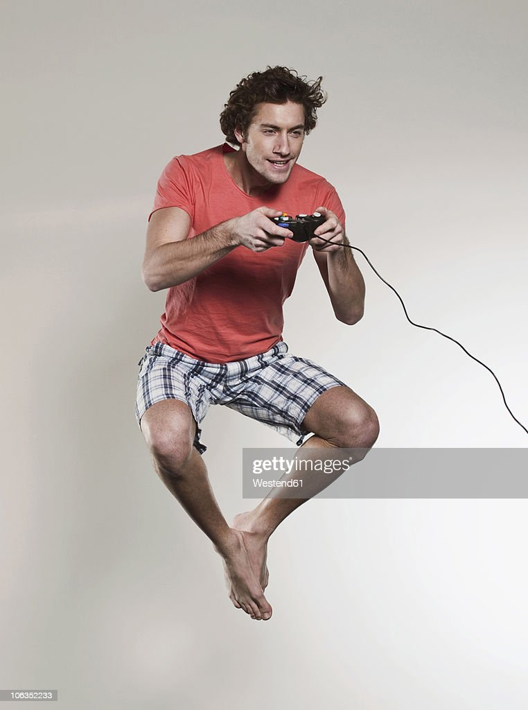 Man playing vedio game and jumping