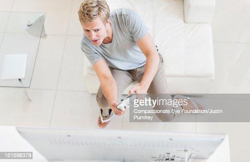 Man playing video games : Stock Photo