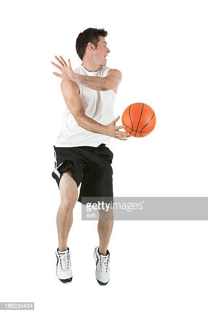 Man playing with a basketball