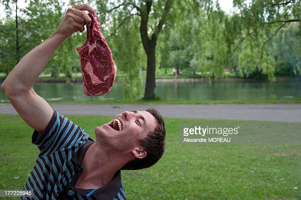 Man playing with big meat steak