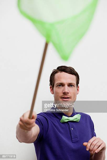 man playing with butterfly net