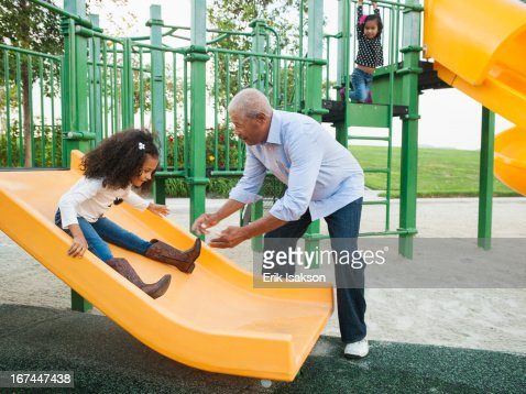Man playing with granddaughter at park : Stock Photo