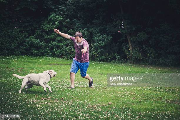 Man playing with his pet dog
