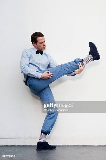 man playing with legs