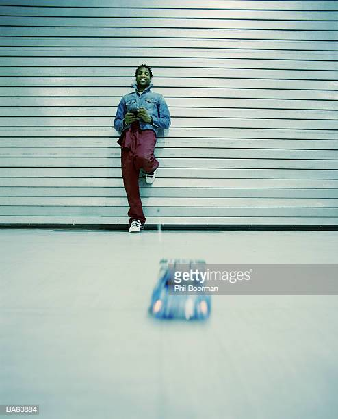 Man playing with remote control car (blurred motion)