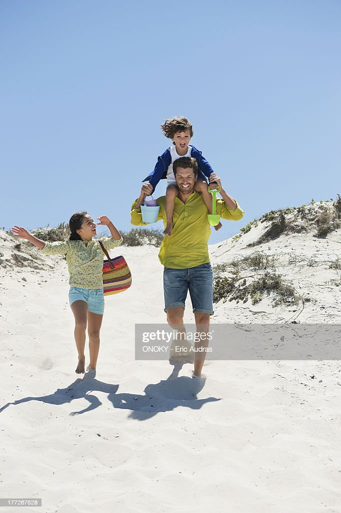 Man playing with their children on the beach