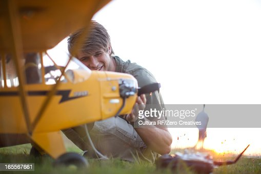 Man playing with toy airplane in park