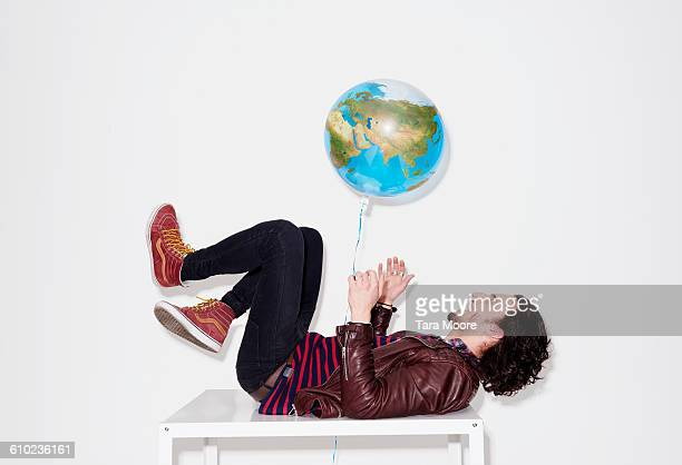 man playing with world balloon