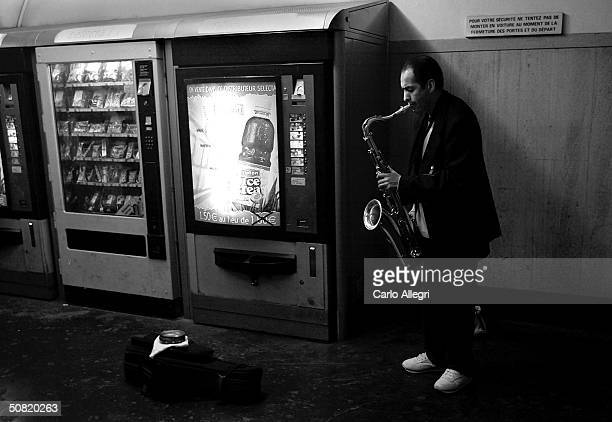 A man plays a saxaphone in a metro station May 6 2004 in Paris France Recently the CIA has warned the French domestic counterintelligence agency of a...
