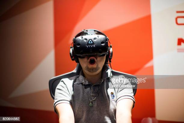 A man plays a virtual reality Mario Kart game at the Bandai Namco game facility of VR Zone Shinjuku in Tokyo on July 22 2017 / AFP PHOTO / Behrouz...