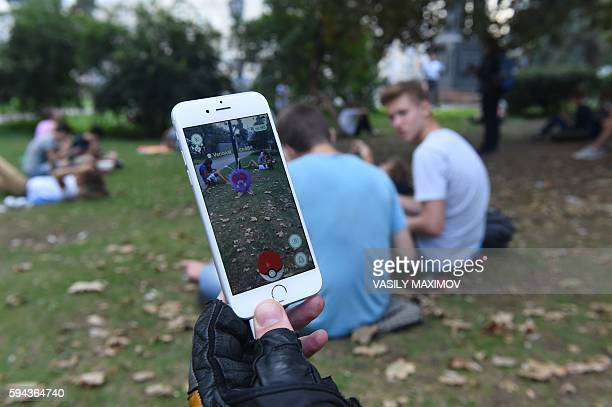 A man plays at the Pokemon GO augmented reality game in central Moscow on August 23 2016 A compass on the smartphone screen points towards Red Square...