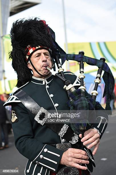 A man plays bagpipes outside the stadium ahead of the Pool B match of the 2015 Rugby World Cup between Scotland and Japan at Kingsholm stadium in...