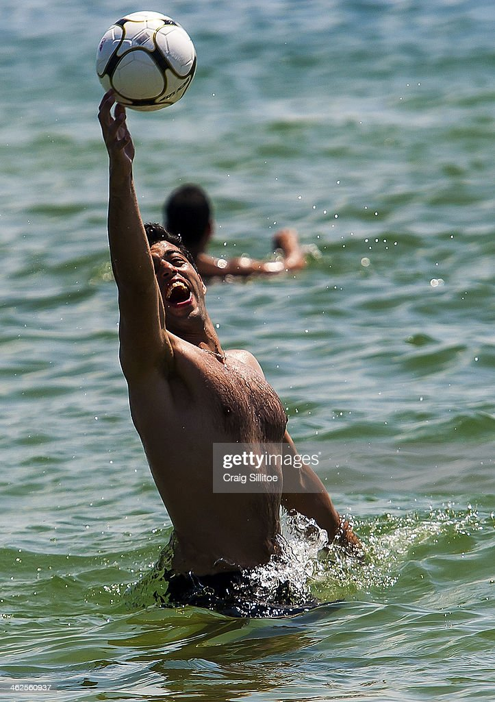 A man plays ball at Elwood Beach on January 14, 2014 in Melbourne, Australia. Temperatures are expected to reach over 40 degrees Celsius in parts of Victoria over the next four days.