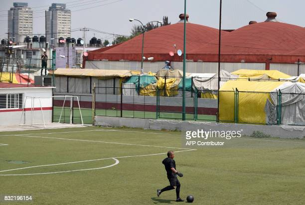 A man plays during a match in which both teams have black uniforms as part of a performance called 'Todos Contra Todos' of Chilean artist Camilo...
