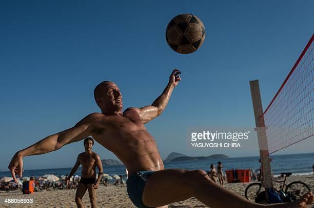 A man plays footvolley at Ipanema beach in Rio de Janeiro Brazil on January 30 2014