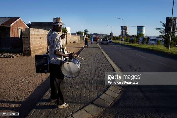 A man plays his drums on the streets to make some cash on January 1 2013 Orlando section of Soweto South Africa Despite the residents adapting to...