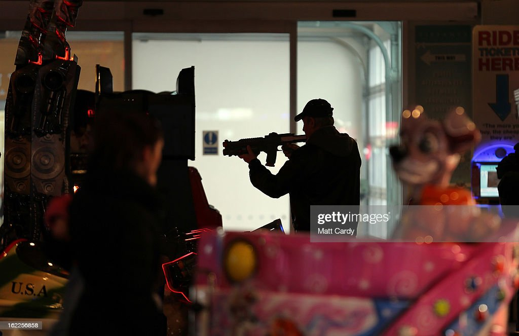A man plays on an arcade game inside the Grand Pier on February 21, 2013 in Weston-Super-Mare, England. According to recently released figures by the Ministry Of Justice, Weston-super-Mare has the highest rate of divorce in the UK.