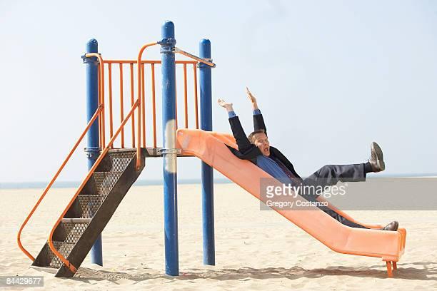 Man Plays on Slide