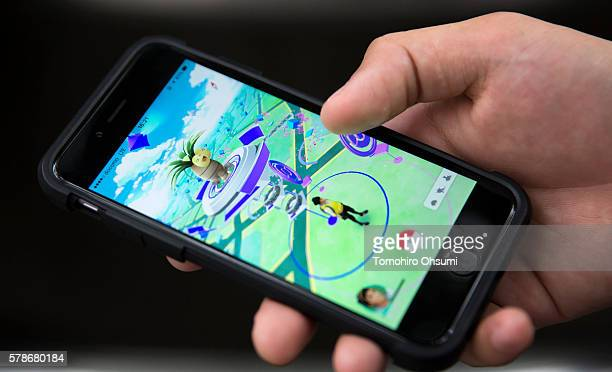 A man plays Pokemon Go game on a smartphone on July 22 2016 in Tokyo Japan The Japanese version of the game app Pokemon Go was released on July 22...