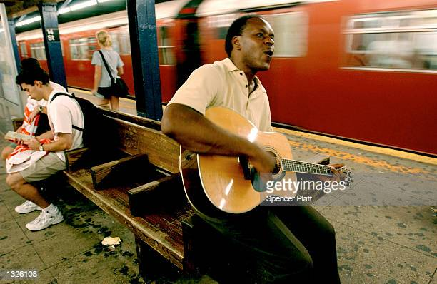 A man plays soul classics on his guitar at a subway station July 13 2001 in New York City Hundreds of New York musicians who perform in the...