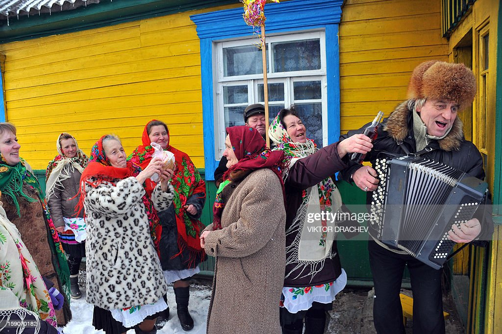A man plays the accordion as people gathered during Christmas celebration in the town of Richev, some 290 km south from Minsk. on January 7, 2013. Orthodox Christians celebrate Christmas on January 7 in the Middle East, Russia and other Orthodox churches that use the old Julian calendar instead of the 17th-century Gregorian calendar adopted by Catholics, Protestants, Greek Orthodox and commonly used attendsin secular life around the world.