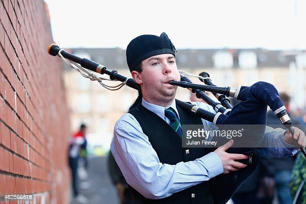 A man plays the bagpipes before the Scottish League Cup SemiFinal match between Dundee United and Aberdeen at Hampden Park on January 31 2015 in...