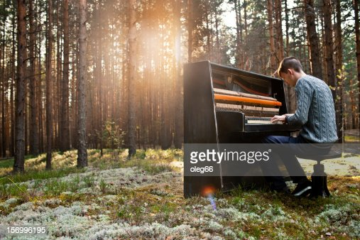man plays the piano