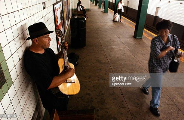 A man plays traditional spanish songs on his guitar at a subway station July 13 2001 in New York City Hundreds of New York musicians who perform in...