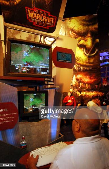 A man plays 'Warcraft Reign of Chaos' by Blizzard Entertainment on the first day of E3 the Electronic Entertainment Expo May 22 2002 at the Los...