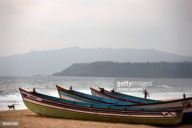 A man plays with sticks at Agonda beach in Goa on March 19 2008 Goa a main touristic area accounts for nearly 12 percent of the four million tourists...