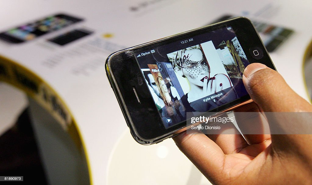 A man plays with the new Apple iPhone at the George Street Optus Store on July 11, 2008 in Sydney, Australia. The iPhone 3G is a multimedia mobile device with a touch screen that enables email and web browsing.