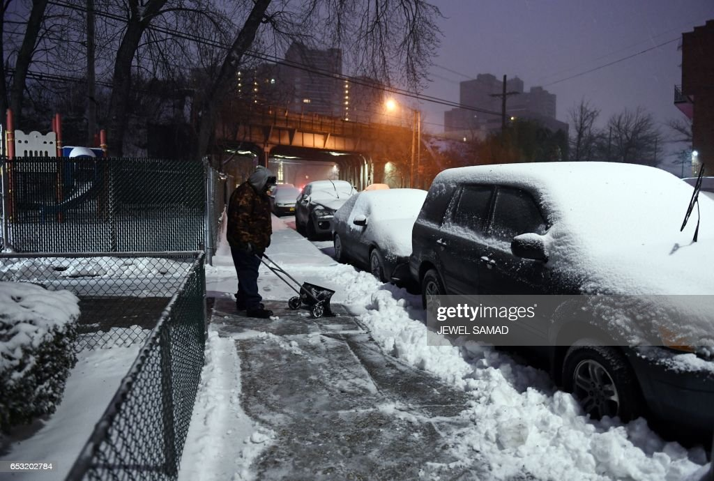 A man plows snow from a sidewalk during a snowstorm in New York on March 14, 2017. Winter Storm Stella unleashed its fury on much of the northeastern United States on Tuesday, dropping snow and sleet across the region and leading to school closures and thousands of flight cancellations. Stella, the most powerful winter storm of the season, was forecast to dump up to two feet (60 centimeters) of snow in New York and whip the area with combined with winds of up to 60 miles per hour (95 kilometers per hour), causing treacherous whiteout conditions. PHOTO / Jewel SAMAD