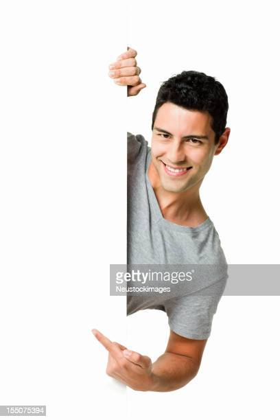 Man Pointing Around a Wall - Isolated