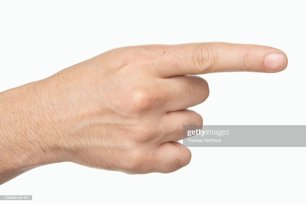 Man pointing finger (focus on hand)
