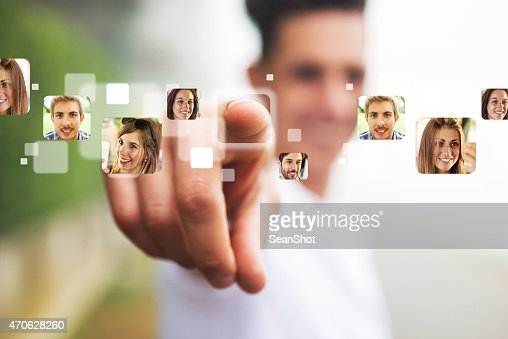 Man pointing his Finger on People's Photographs
