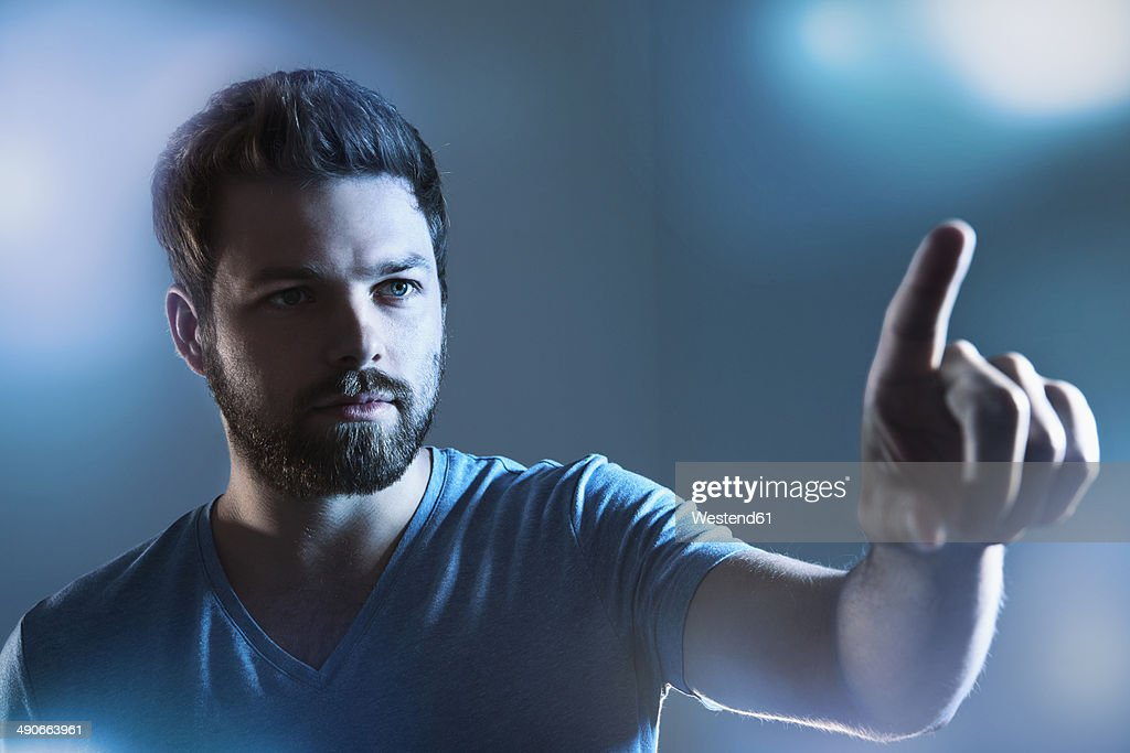Man pointing on imaginary touchscreen