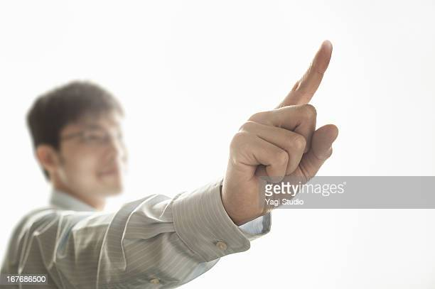 Man pointing to the index finger