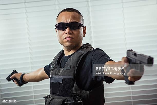 Man pointing two handguns