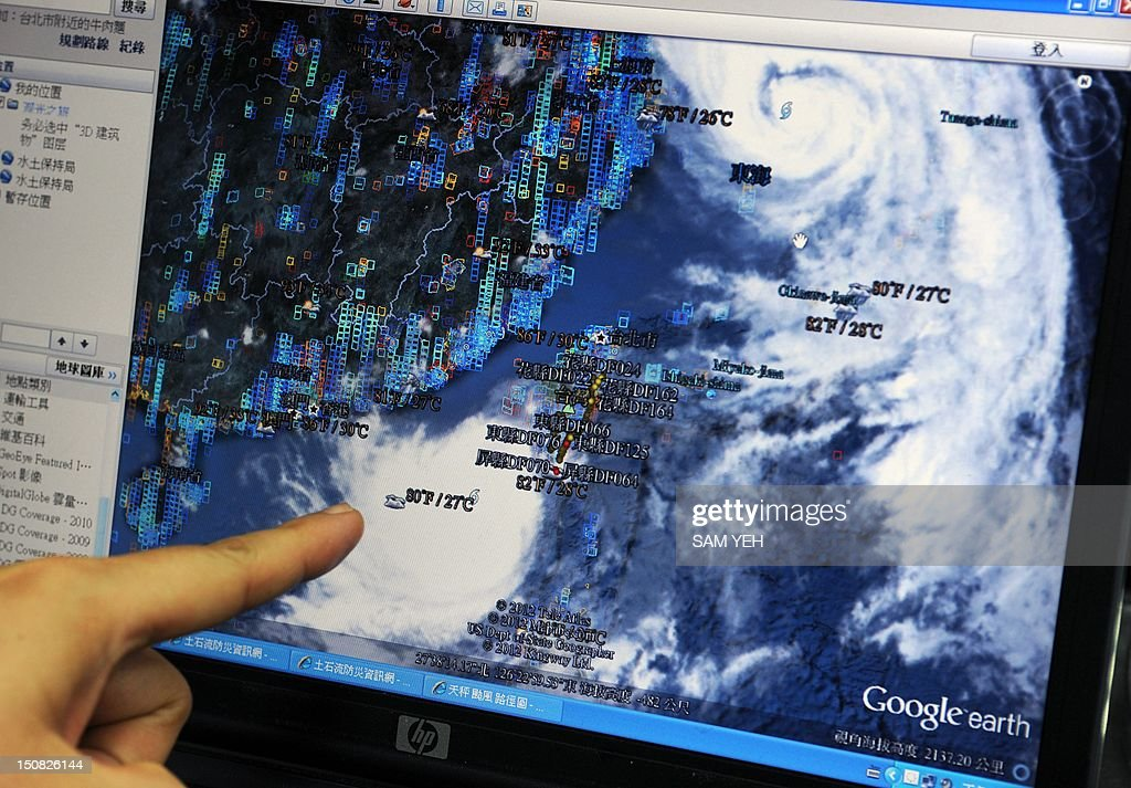 A man points at a satellite chart of Typhoon Tembin in Hengchun, a township in Taiwan's southern Pingtung county on August 27, 2012. Taiwan was bracing for the likely return of Typhoon Tembin, forecasting that it may hit the same area where only days ago it unleashed the worst rains in more than a century.