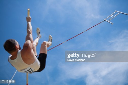 'Man pole vaulting, low angle view'