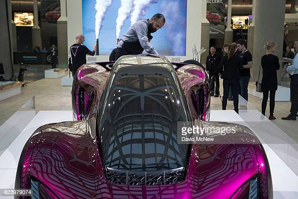 A man polishes a 3D printed car made by Divergent 3D which is claimed to be a more environmentally friendly and cost effective way to build cars is...