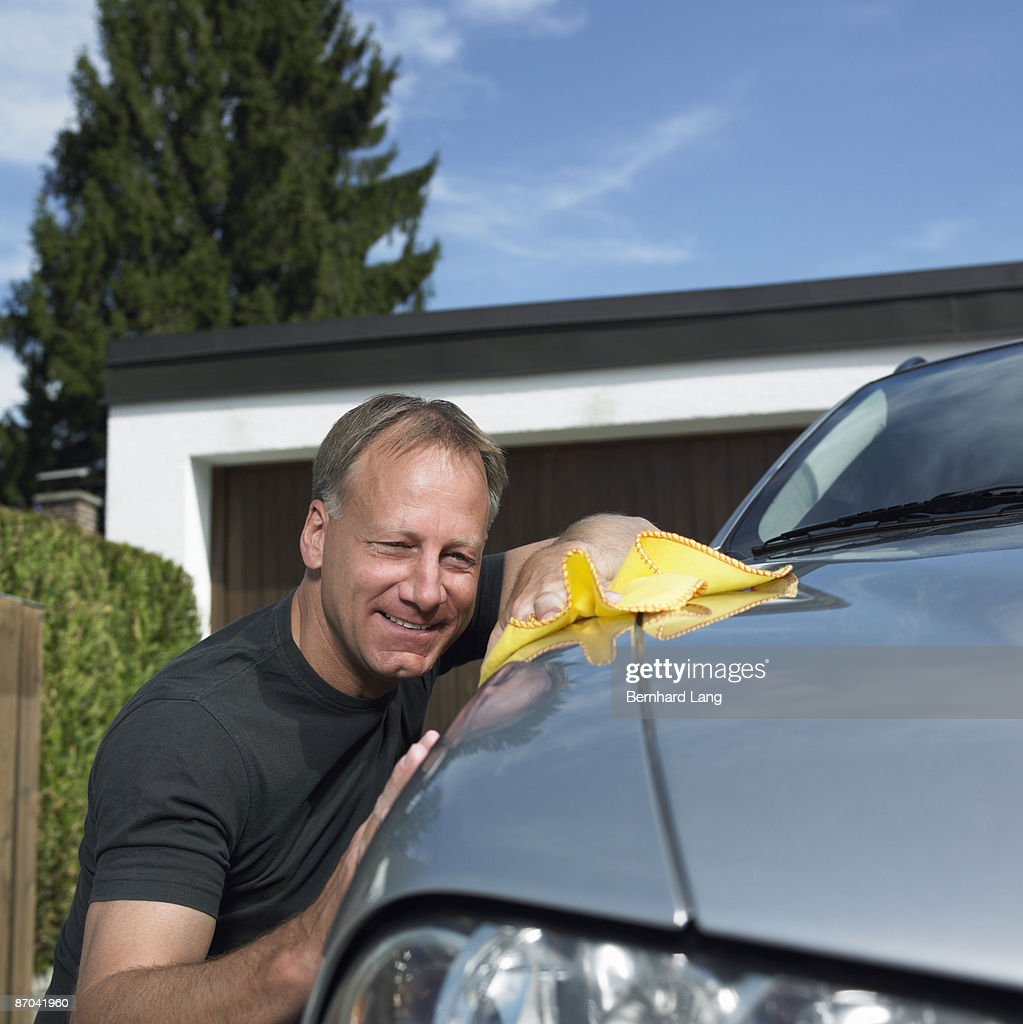 Man polishing car : Stock Photo